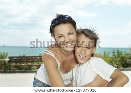 Mother and child on the background of the sea - stock photo