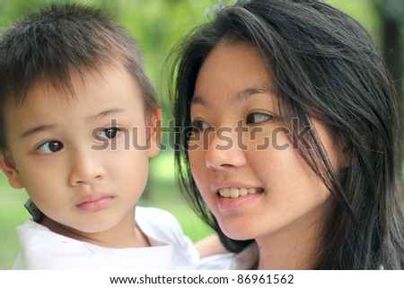 Mother and child outdoors in the park