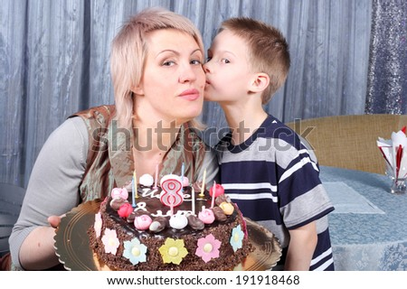 mother and child with the birthday cake - stock photo