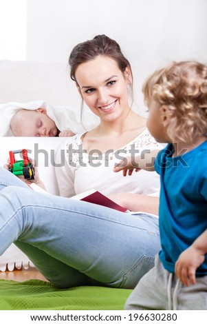 Mother and children during free time, vertical - stock photo