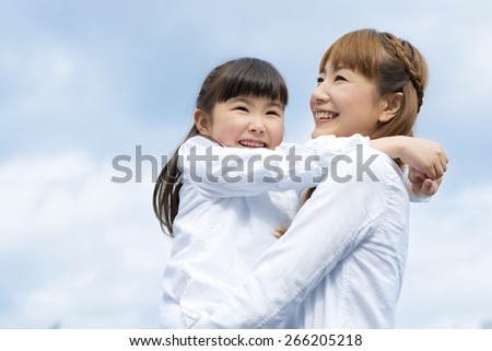mother and daughter are both close - stock photo