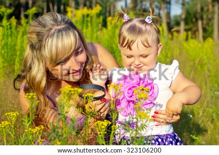 Mother and daughter are studying the environment - stock photo