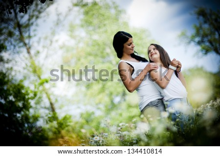 Mother and daughter are together in the park