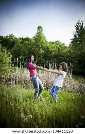 Mother and daughter are together in the park - stock photo
