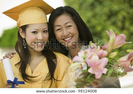 Mother and Daughter at Graduation - stock photo