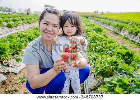 Mother and daughter at strawberry farm