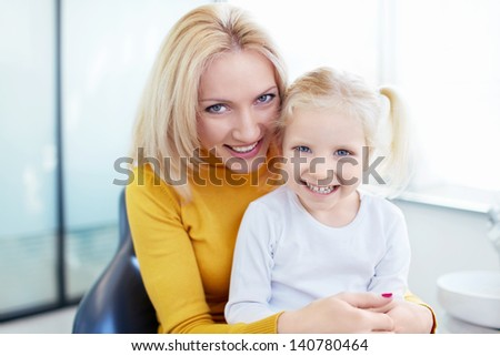 Mother and daughter at the doctor - stock photo