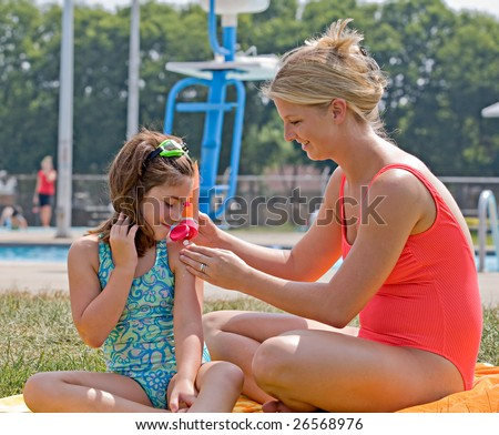 Mother and Daughter at the Pool - stock photo