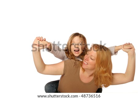 Mother and daughter being playful - stock photo