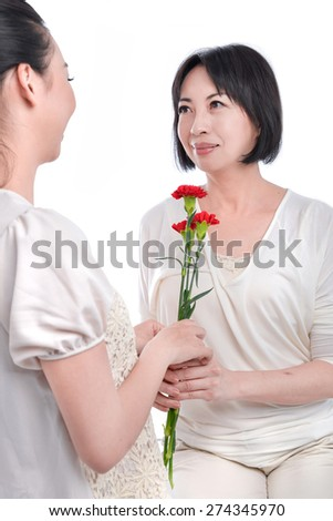 mother and daughter celebrating mother's day - stock photo