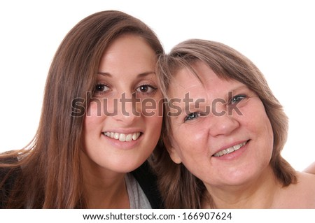 mother and daughter cheek to cheek - stock photo