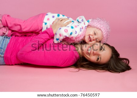 Mother and daughter child playing - stock photo