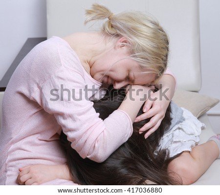 mother and daughter cry
