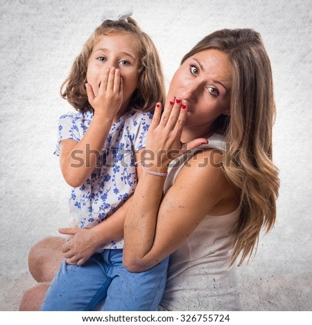 Mother and daughter doing surprise gesture