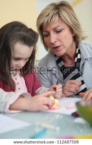 Mother and daughter drawing - stock photo