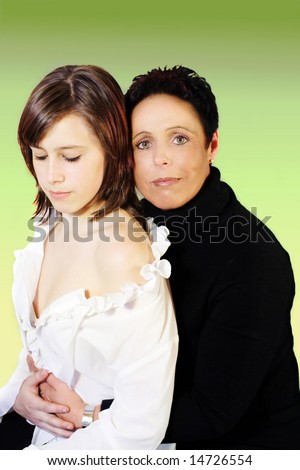 Mother and daughter embraced in black and white clothes