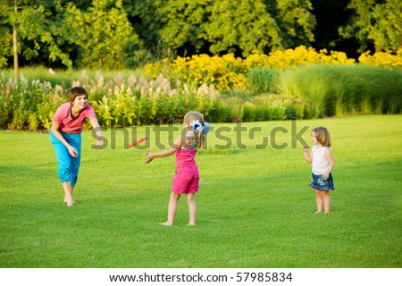 Mother and daughter enjoying frisbie leisure time