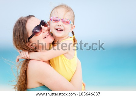 Mother and daughter enjoying summer beach vacation