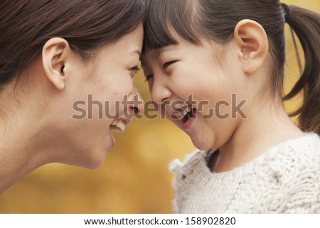 Mother and daughter face to face - stock photo