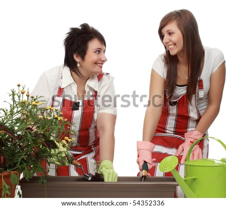 mother and daughter gardening, white background - stock photo
