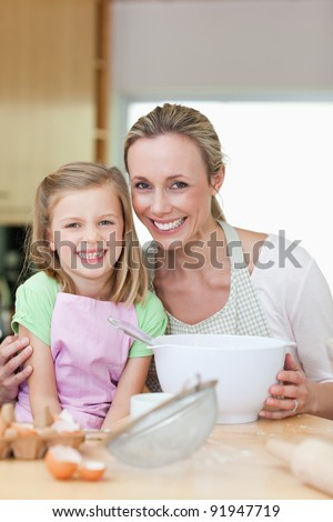 Mother and daughter having a good time in the kitchen