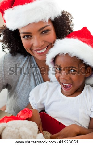 Mother and daughter having fun at Christmas time at home - stock photo