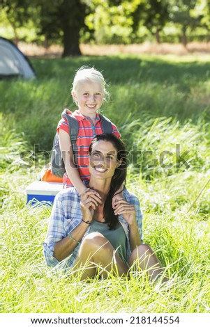 Mother And Daughter Having Fun On Countryside Camping Trip