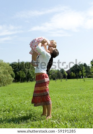 mother and daughter having fun on meadow