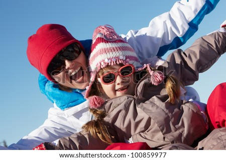Mother And Daughter Having Fun On Ski Holiday In Mountains