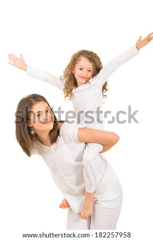 Mother and daughter having fun together isolated on white background - stock photo