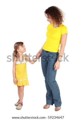 mother and daughter holding for hands looking to each other and smiling isolated on white