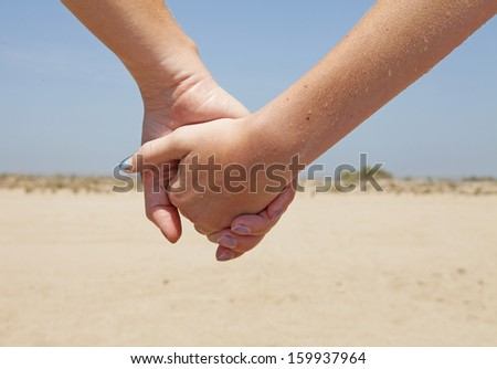 Mother and daughter holding hand