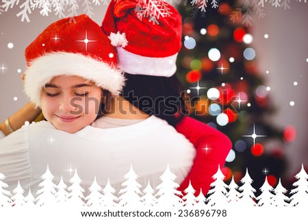 Mother and daughter hugging at christmas against fir tree forest and snowflakes - stock photo