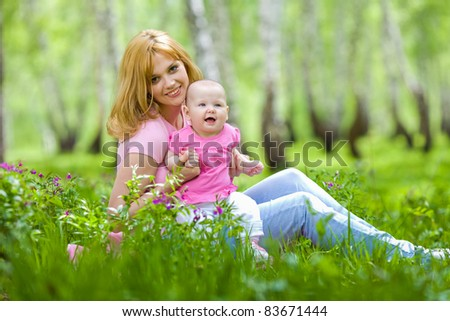 Mother and daughter in birch spring park - stock photo