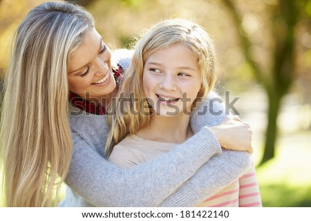 Mother And Daughter In Countryside - stock photo