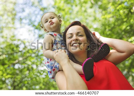 Mother and daughter in forest having fun