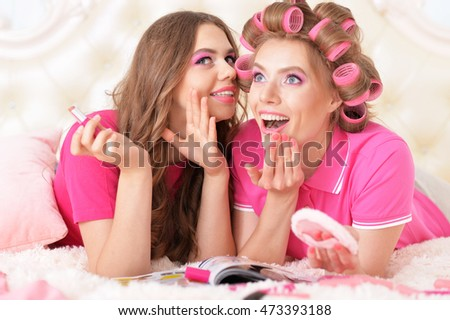 Mother and  daughter in hair curlers