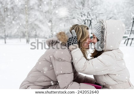 Mother and daughter in love, winter landscape - stock photo