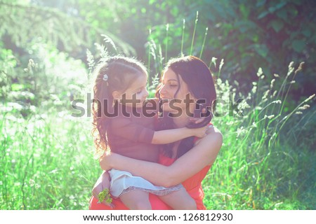 mother and daughter in summer day - stock photo