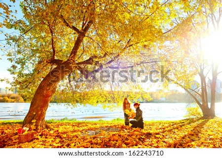 Mother and daughter in the autumn nature - stock photo