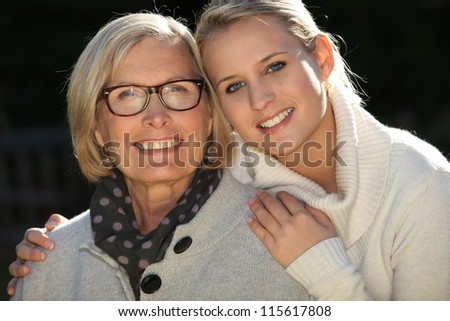 Mother and daughter in the garden - stock photo