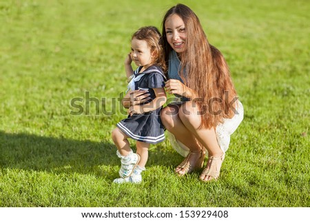 Mother and daughter in the park happy  - stock photo