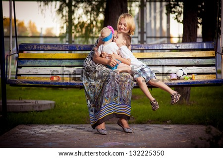 Mother and daughter in the park. Mother and her child enjoy the early spring. Happiness - mother with her child.Young mother with child outside on a summer day. mother playing with her son in the park - stock photo