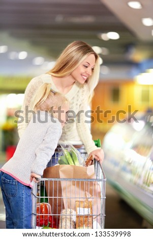 Mother and daughter in the store - stock photo