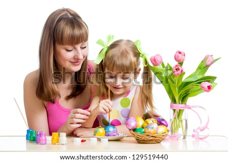 mother and daughter kid paint easter eggs isolated - stock photo