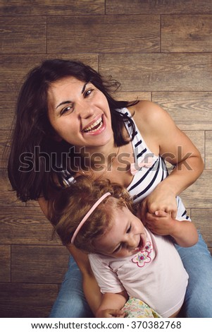 mother and daughter laughing and having fun