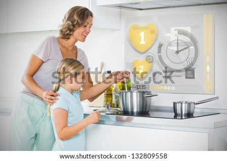 Mother and daughter making dinner using futuristic interface in the kitchen - stock photo