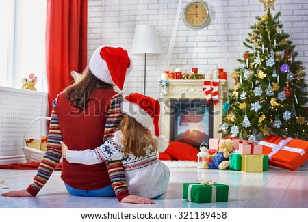 Mother and daughter making preparations for Christmas - stock photo