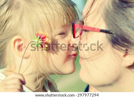 Mother and daughter. MANY OTHER PHOTOS FROM THIS SERIES IN MY PORTFOLIO. - stock photo