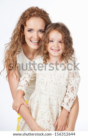 Mother and daughter, on a gray background - stock photo
